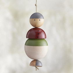 Mom Ornament - Our friendly family members are crafted in simple shapes of pinewood, strung together on a cord and finished with colorful painted details. Coordinating mom, dad and child ornaments let you gather an entire family to decorate your holiday tree. Studiopatró founding artist Christina Weber strives for memorable simplicity in everything she creates. Her sources of inspiration—architecture, nature and pattern—can be seen in her ornament designs, crafted of pale wood with bright strokes of color.