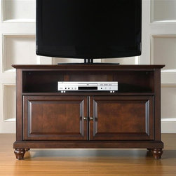 """Crosley Furniture - Cambridge 42"""" TV Stand in Mahogany - Beautiful Raised Panel Doors. Antique Brass Finish Hardware. Adjustable Shelf. Wire Management. Adjustable Levelers in Legs. Accomodates most 44"""" TV's. Solid Hardwood & Veneer Construction. 26in. H x 42in. W x 18in. D (71 lbs)Constructed of solid hardwood and wood veneers, this cabinet is designed for longevity. The rich, hand rubbed, multi-step Vintage Mahogany finish is perfect for blending with the family of furniture that is already part of your home. Antique Brass finish hardware adds a touch of style to this already beautiful cabinet. There is plenty of storage space and wire management behind the beautiful raised panel doors to hide electronic components, gaming consoles, DVDs, and other items that you would prefer to be out of sight. The 42"""" width means that this cabinet is perfect for most 44"""" TV's. Style, function, and quality make this cabinet a wise choice for your home furnishings needs, and is sure to be a part of your home for years to come."""