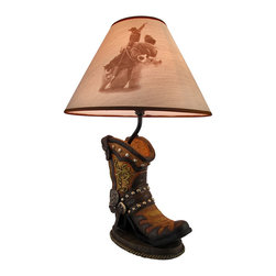Zeckos - Western Cowboy Boot Table Lamp with Bronc Rider Print Shade - This awesome table lamp features a Western cowboy boot, complete with conchos and spur. Measuring 19 inches tall, including the rodeo print 13 inch diameter shade, the lamp is a wonderful decorative accent for lovers of Western decor. It uses appliance sized light bulbs up to 45 watts.