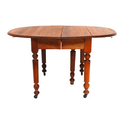 Used Vintage French Drop Leaf Dining Table - Get your French country on with this vintage French pine drop leaf dining table from Normandy, France. This classic is complete with two drop-leaf sides and one insert. In excellent condition with beautiful patina from decades of use and highly detailed carved legs on castors. One of a kind! Circa the 1900s.