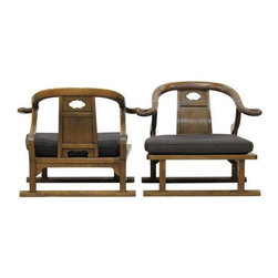 Used Chinese Horseshoe Armchairs - A Pair - These two stunning wooden chairs feature horseshoe backs, black cushions, and brass detailing. The S-curved back splats make these chairs comfortable, low-profile seating for a living room or entryway.
