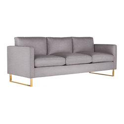 Goodland Sofa in Fabric, Bronze Legs - Milo Baughman believed that good design is enduring design, and his Goodland Sofa Collection (1968) beautifully demonstrates this idea. Named for the Kansas town where he was born, Goodland reflects the style and ease for which Baughman is known. This collection began as a sofa designed for his own home – his daughter still has the original – which he later expanded upon and launched for retail customers. Goodland pieces are elegantly proportioned with comfortable cushions that have just the right give and thin arms that help maximize the seating area. Made in U.S.A.