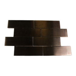 """Metal Rose Stainless Steel Tiles - METAL ROSE STAINLESS STEEL 2x6 TILES The clean geometric design with the metal rose stainless steel is chic and visually striking. The tile will provide any room with a sleek, stylish and contemporary appearance. This is a great alternative to use for in a kitchen backsplash, feature wall or as decorative borders. Chip Size: 2"""" x 6"""" Color: Metal Rose Material: Stainless Steel Finish: Matte Sold by the Square Foot - 12 pieces per sq. ft. Thickness: 5mm"""