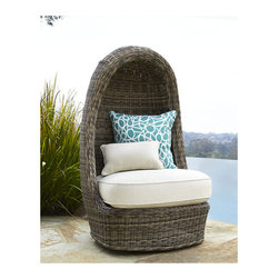 'Summer' Swivel Lounge Chair - This is definitely a unique piece for any outdoor space, but in a subtle natural rattan with a white cushion, it's not obtrusive. It swivels — so it's perfect for keeping your iPad in the shade.
