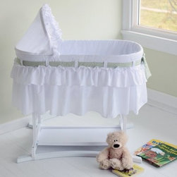 Lamont Home Good Night Baby Short Skirt Bassinet - Breezy and cute like a baby's bed should be, the Lamont Home Good Night Short Skirt Bassinet is everything you expect. This beautiful bassinet sits on a stable wood frame made in the USA, with wide, curved legs and a three-point locking system that lets you breathe easy. Speaking of breathing, the 80/20 poly cotton liner and ventilated sides are designed to keep the fresh air coming to those little longs. It's all clean white with interchangeable color bows. Some assembly with minimal tools is required.About Lamont HomeLocated in Burlington, Iowa, where it was founded 40 years ago, Lamont Home is dedicated to designing and selling products that enhance the lives of those they touch. They pride themselves on Midwestern values in quality, materials, and customer service. For nearly every room in your home, you'll find something from Lamont Home that's exactly what you've been looking for.