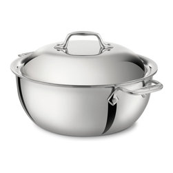All-Clad - All-Clad Stainless Steel 5.5 Qt. Dutch Oven w/Lid - Prepare flavorful slow-cooked meals in a single pot with the All-Clad 5.5-Quart Chef Series Dutch Oven. Made for braising, stewing, browning, and slow cooking, this large-capacity Dutch oven has a domed lid designed for returning moisture and flavor to your meal. The round bottom features All-Clad's stick-resistant starburst finish, and the three-ply stainless steel construction distributes heat evenly. Safe to use on all cooktops, this Dutch oven comes with eight recipes created and tested by All-Clad's elite chef partners. Large Pot Ideal for One-Pot Meals This large Dutch oven is designed for braising, stewing, browning, and slow cooking. The domed lid retains moisture by returning flavorful vapors to back the food as you prepare hearty stews or tasty cuts of meat. This piece comes with eight recipes created for this Dutch oven by All-Clad's chef ambassadors. Interior Finish and Shape Prevent Sticking The interior of this Dutch oven features All-Clad's stick-resistant starburst finish. The round bottom makes for effortless stirring and prevents food from getting stuck in any edges. It can be washed in the dishwasher without affecting the finish. Stainless Steel Construction for Even Heating Made with 18/10stainless steel, this Dutch oven is compatible to use with all cooktops, including induction, and the interior finish will not react with food. The stainless steel handles are permanently secured with stainless steel rivets, sturdy enough to help you lift heavy meals. Premium tri-ply construction delivers even heat distribution throughout the pan.