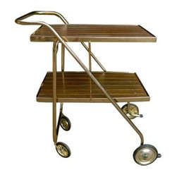 Rolling Mid-Century Modern Bar Cart - A Mid-Century modern bar cart on wheels! This brass colored cart collapses and can be easily stored under a bed or in a closet. This serving cart is in good vintage condition, with normal age related tarnish and scrapes and a few surface fade spots. Super cool vintage piece!