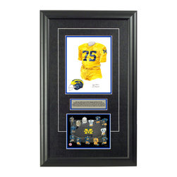 """Heritage Sports Art - Original art of the NCAA 1964 Michigan Wolverines uniform - This beautifully framed NCAA football piece features an original piece of watercolor artwork glass-framed in an attractive two inch wide black resin frame with a double mat. The outer dimensions of the framed piece are approximately 17"""" wide x 28"""" high, although the exact size will vary according to the size of the original piece of art. At the core of the framed piece is the actual piece of original artwork as painted by the artist on textured 100% rag, water-marked watercolor paper. In many cases the original artwork has handwritten notes in pencil from the artist. Simply put, this is beautiful, one-of-a-kind artwork. The outer mat is a rich textured black acid-free mat with a decorative inset white v-groove, while the inner mat is a complimentary colored acid-free mat reflecting one of the team's primary colors. The image of this framed piece shows the mat color that we use (Medium Blue). Beneath the artwork is a silver plate with black text describing the original artwork. The text for this piece will read: This is an original, one-of-a-kind watercolor painting of the 1964 Michigan Wolverines uniform worn by #75 Bill Yearby and was used in the creation of this Michigan Wolverines uniform evolution print and thousands of Michigan products that have been sold across North America. This original piece of art was painted by artist Nola McConnan for Maple Leaf Productions Ltd. This painting has become quite famous because it actually shows an incorrect jersey color - the jersey should have been painted white but was in fact painted yellow. Beneath the silver plate is a 6.5"""" x 7"""" reproduction of a uniform evolution print that celebrates the history of the team. The print beautifully illustrates the chronological evolution of the team's uniform and shows you how the original art was used in the creation of this print. If you look closely, you will see that the print features the actual ar"""