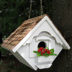 Little Wren Hanging Bird House - This hanging bird house is designed to accommodate house wrens. Topped with natural red cedar, this charming little cottage has a window box frame and planter with decorative flowers. The fully functional house has a bottom panel that can be easily removed for yearly cleaning. Includes a sturdy brass chain for hanging.