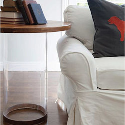 Side Table - A cylindrical pillar of the clearest acrylic gets a more stable look on your floor with a narrow base of medium wood veneer, matching the reclaimed wood that forms this transitional round end table's top. In this occasional surface both polished and practical, the circular base bends the light just enough for a pleasing waver but lets the colors of your interior design show through, while the top provides a naturalistic background for vignettes or artful table lamps.
