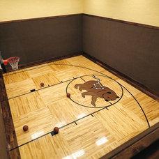 Rustic Home Gym by Kotzen Interiors, LLP