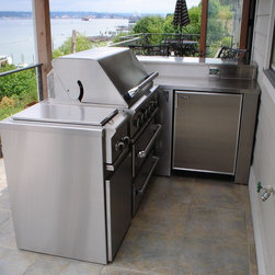 Custom fabricated BBQ - We helped design and fabricate this custom BBQ area for our customer. We fabricated custom stainless steel counter tops and core to fit with their own outdoor BBQ.