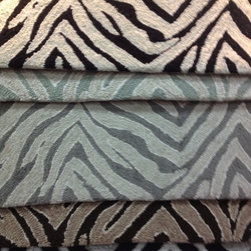 Showroom Products - Great looking animal print - offered as area rugs or wall to wall carpet.  Introduced at Surfaces 2013 in Las Vegas.
