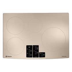 """GE Monogram - GE Monogram® 30"""" Induction Cooktop - The appeal of Monogram appliances is unmistakable and powerful. This is especially true of Monogram induction cooktops, which use electromagnetic energy to transform cookware into an instant source of heat."""
