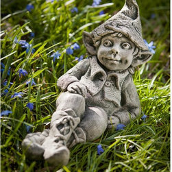 Campania International - Campania International Colin The Elf Cast Stone Garden Statue - S-391-AL - Shop for Statues and Sculptures from Hayneedle.com! About Campania InternationalEstablished in 1984 Campania International's reputation has been built on quality original products and service. Originally selling terra cotta planters Campania soon began to research and develop the design and manufacture of cast stone garden planters and ornaments. Campania is also an importer and wholesaler of garden products including polyethylene terra cotta glazed pottery cast iron and fiberglass planters as well as classic garden structures fountains and cast resin statuary.Campania Cast Stone: The ProcessThe creation of Campania's cast stone pieces begins and ends by hand. From the creation of an original design making of a mold pouring the cast stone application of the patina to the final packing of an order the process is both technical and artistic. As many as 30 pairs of hands are involved in the creation of each Campania piece in a labor intensive 15 step process.The process begins either with the creation of an original copyrighted design by Campania's artisans or an antique original. Antique originals will often require some restoration work which is also done in-house by expert craftsmen. Campania's mold making department will then begin a multi-step process to create a production mold which will properly replicate the detail and texture of the original piece. Depending on its size and complexity a mold can take as long as three months to complete. Campania creates in excess of 700 molds per year.After a mold is completed it is moved to the production area where a team individually hand pours the liquid cast stone mixture into the mold and employs special techniques to remove air bubbles. Campania carefully monitors the PSI of every piece. PSI (pounds per square inch) measures the strength of every piece to ensure durability. The PSI of Campania pieces is currently engineered at approximately 7500 for optimum strength. Each piece is air-dried and then de-molded by hand. After an internal quality check pieces are sent to a finishing department where seams are ground and any air holes caused by the pouring process are filled and smoothed. Pieces are then placed on a pallet for stocking in the warehouse.All Campania pieces are produced and stocked in natural cast stone. When a customer's order is placed pieces are pulled and unless a piece is requested in natural cast stone it is finished in a unique patinas. All patinas are applied by hand in a multi-step process; some patinas require three separate color applications. A finisher's skill in applying the patina and wiping away any excess to highlight detail requires not only technical skill but also true artistic sensibility. Every Campania piece becomes a unique and original work of garden art as a result.After the patina is dry the piece is then quality inspected. All pieces of a customer's order are batched and checked for completeness. A two-person packing team will then pack the order by hand into gaylord boxes on pallets. The packing material used is excelsior a natural wood product that has no chemical additives and may be recycled as display material repacking customer orders mulch or even bedding for animals. This exhaustive process ensures that Campania will remain a popular and beloved choice when it comes to garden decor.Please note this product does not ship to Pennsylvania.