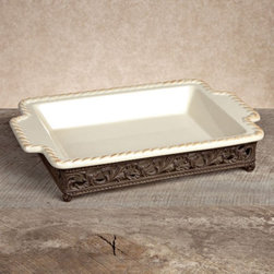 Gerson Company - GG Collection Baker with Metal Base - Cream Multicolor - 31524 - Shop for Trays from Hayneedle.com! A baking dish of striking traditional elegance the Gerson GG Collection Gracious Goods Baker with Metal Base Cream is a dish you'll love to display whether you're serving a delicious dinner or using it as an eye-catching accent. It features a cream-finished ceramic interior and brown cast aluminum base a traditional style that's adapted to contemporary needs via its microwave- dishwasher- and oven-safe design plus your choice of large sizes.