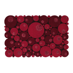 Bubbles Red Rug - The circles on this rug create an interesting edge, a rare deviation from the standard perfect rectangle. There are three levels, each a different height.