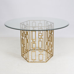 Jackson Gold Leafed Dining Table - The geometric design of the base, paired with a clear beveled glass top, makes this one chic dining table.