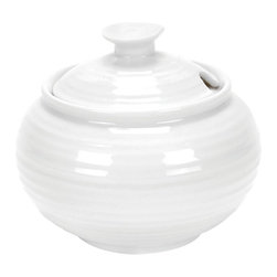 Portmeirion - Sophie Conran White Covered Sugar Jar - 432437 - Shop for Bowls and Candy Dishes from Hayneedle.com! Let the Sophie Conran White Covered Sugar Jar give you a little sugar whenever you need it. Whether you're enjoying coffee alone or with friends this simple yet stylish sugar jar will look right at home on your table. Plus it's microwave- and dishwasher- safe.About PortmeirionStrikingly beautiful eminently practical refreshingly affordable. These are the enduring values bequeathed to Portmeirion by its legendary co-founder and designer Susan Williams-Ellis. Her father architect Sir Clough Williams-Ellis was the designer of Portmeirion the North Wales village whose fanciful architecture has drawn tourists and artists from around the world (including the creators of the classic 1960s TV show The Prisoner). Inspired by her fine arts training and creation of ceramic gifts for the village's gift shop Susan Williams-Ellis (along with her husband Euan Cooper-Willis) founded Portmeirion Pottery in 1960. After 50+ years of innovation the Portmeirion Group is not only an icon of British design but also a testament to the extraordinarily creative life of Susan Williams-Ellis.The style of Portmeirion dinnerware and serveware is marked by a passion for both pottery manufacturing and trend-setting design. Beautiful tactile nature-inspired patterns are a defining quality of Portmeirion housewares from its world-renowned botanical designs modeled on antiquarian books to the breezy natural colors of its porcelain and earthenware. Today the Portmeirion Group's design legacy continues to evolve through iconic brands such as Spode the Pomona Classics collection and the award-winning collaboration of Sophie Conran for Portmeirion. Sophie Conran for Portmeirion:Successful collaborations have provided design inspiration throughout Sophie Conran's life. Her father designer Sir Terence Conran and mother food writer Caroline Conran have been the pillars of her eclectic mix of cooking writing and interior design. In pairing with the iconic British housewares brand Portmeirion Conran has created another successful collaboration: Sophie Conran for Portmeirion an award-winning collection of dinnerware serveware and drinkware for the practical multi-functional needs of contemporary kitchens.Launched in 2006 Sophie Conran for Portmeirion immediately received the Elle Deco Style Award for Best in Kitchens and two years later the House Beautiful Award for Best in Tableware. The soulful tactile beauty of these oven-to-tableware pieces is exemplified by rippled surfaces and edges that evoke a potter's hand. This down-to-earth style is complemented by charming pastels gentle earth tones and classic whites and pinks for a collection that will lighten and enliven contemporary kitchen decors. Though delicate to the eye and touch these plates and bowls are built for durable performance with microwave- and dishwasher-safe porcelain that's casual enough for breakfast and elegant enough for eye-catching dinners.