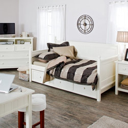 Fashion Bed Group - Casey Daybed - White - RN642 - Shop for Daybeds from Hayneedle.com! With its creamy white finish and subtle cottage style the Casey Daybed in White will bring a fresh cheerful accent to any room in your home. The sides and back are solid panels of wood with rounded wood finials atop each post. The Casey Daybed is great for spare bedrooms kids rooms or as an office-area sofa. This daybed comes with an optional roll-out trundle that can be used for extra storage or sleepover space if you put up to an 8-inch-thick mattress inside (the trundle does not pop up). This daybed uses a standard twin-size mattress. The included wooden slat support system is 15 inches from the floor. Assembly required. Ships via common carrier. Dimensions: Mattress: 74L x 38W x 6H inches Trundle: 76L x 40W x 13H inches Side panel: 33H Finial ball: 3H inches About Fashion Bed GroupFashion Bed Group is a Leggett and Platt Company known for its innovative fashion beds daybeds futons bunk beds bed frames and bedding support. Created in 1991 Fashion Bed Group is a large consolidation of three leading bed manufacturers. Its beds are manufactured of genuine brass plated brass cast zinc cast aluminum steel iron wood wicker and rattan. Fashion Bed Group's products are distributed throughout North America from warehouses located in Chicago Los Angeles Houston Toronto and Ennis Texas.