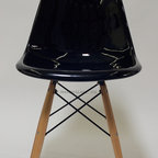 Mason Glass + Co. - Eames Style Fiberglass DSW Side Chair, Black - The Mason Glass + Co.™ Eames Style Molded Fiberglass DSW Side Chair is a faithful reproduction of the original Eames style Molded Fiberglass Chair from the 1950s. A simple, gracious form that fits any body and every place, this chair is an ideal dining chair or office chair option for both formal and informal spaces alike. Quite possibly the most popular of the mid-century modern chair designs, our fiberglass finish has the same covetable surface variation and tell-tale fiberglass striation that have attracted avid vintage collectors for decades. Unlike the flimsy plastic versions of this chair, our molded fiberglass chair is extremely sturdy and will withstand many years of use. Available in four classic colors with wooden dowels constructed of sturdy oak.