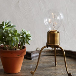 Volta Desk Lamp - If space on the desk or table is limited, this brass light would solve the problem — and look good while doing it.