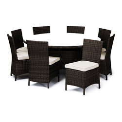 "Reef Rattan - Reef Rattan Capri 9 Pc Round Dining Set - Chocolate Rattan / Beige Cushions - Reef Rattan Capri 9 Pc Round Dining Set - Chocolate Rattan / Beige Cushions. This patio set is made from all-weather resin wicker and produced to fulfill your needs for high quality. The resin wicker in this patio set won't fade, shrink, lose its strength, or snap. UV resistant and water resistant, this patio set is durable and easy to maintain. A rust-free powder-coated aluminum frame provides strength to withstand years of use. Sunbrella fabrics on patio furniture lends you the sophistication of a five star hotel, right in your outdoor living space, featuring industry leading Sunbrella fabrics. Designed to reflect that ultra-chic look, and with superior resistance to the elements in a variety of climates, the series stands for comfort, class, and constancy. Recreating the poolside high end feel of an upmarket hotel for outdoor living in a residence or commercial space is easy with this patio furniture. After all, you want a set of patio furniture that's going to look great, and do so for the long-term. The canvas-like fabrics which are designed by Sunbrella utilize the latest synthetic fiber technology are engineered to resist stains and UV fading. This is patio furniture that is made to endure, along with the classic look they represent. When you're creating a comfortable and stylish outdoor room, you're looking for the best quality at a price that makes sense. Resin wicker looks like natural wicker but is made of synthetic polyethylene fiber. Resin wicker is durable & easy to maintain and resistant against the elements. UV Resistant Wicker. Welded aluminum frame is nearly in-destructible and rust free. Stain resistant sunbrella cushions are double-stitched for strength and are fully machine washable. Removable covers made with commercial grade zippers. Tables include tempered glass top. 5 year warranty on this product. PLEASE NOTE: Throw pillows are NOT included. Round Table: W 64"" D 64"" H 29"", Chairs (8): W 24"" D 18"" H 34"""