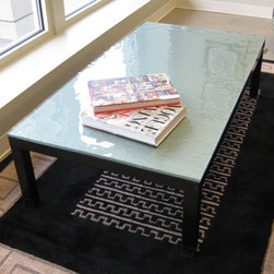 Featured finds at Home Consignments - Contemporary glass top coffee table