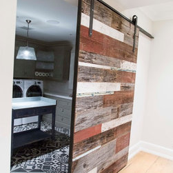 Sliding Barn Door - Mixed Bag - This door was made from a mixture of reclaimed woods from around the yard, including some vintage trim off an old farm house.  The customers walked our yard and hard selected each piece.