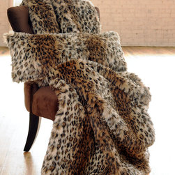 "Valentino Throw - 48"" x 80"" Faux Fur - There is a touch of Tinseltown glam about the Valentino Faux Fur Throw. Sleek and smooth, like the cheetah after which it's patterned, it calls to mind the heyday of Hollywood when homes hidden in the hills welcomed with fab furnishings and whispered promises. The plush, generously-sized throw bestows warmth as well as good looks to your transitional decor."