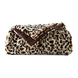 Royal Velvet Faux-Leopard Fur Throw - There's a leopard throw on Mary McDonald's white bench in her living room. You can afford this super soft and cuddly one.