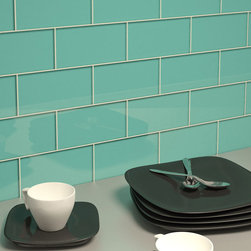 "Subway Tile In Teal 3 X 6 Sample - Glass Mosaic is a handmade product and therefore can vary in color.  Product weight: 0.5 lbs. Product height: 3"". Product width: 6"". Product depth: 0.315"". Square feet per carton: 4. Collection name: Subway. Material type: Glass. Recommended grout width: 0.125"". Surface finish: Glossy. Pieces per carton: 32. Shipping weight per carton: 16 lbs. Tile Use: Walls/Backsplashes. Color: Teal. Shade Variation: V1, Uniform"