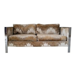 """Used Milo Baughman Chrome & Geometric Print Love Seat - This fantastic sofa is an original Milo Baughman for Thayer Coggin piece and is in good condition for its age. The upholstery on the loveseat is a great funky velvet Larsen style fabric that has some condition issues, but is still in great shape under casual observation. The fabric appears to be threadbare in a couple places which has resulted in a couple small breaks/tears in the fabric, but really hardly noticeable.     The chrome is also in """"good"""" condition with one arm that has been rubbed almost raw of the chrome plating - still a gorgeous piece of furniture! The seller would grade this sofa about a 6 on a scale of 1-10, and a prime candidate for restoration. However, if you're a lover of true mid mod furnishings you'll love this sofa as-is as much as we do!"""
