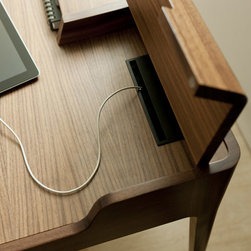 Porada Wood Furnishings - The beautiful Saffo desk by Porada is available in solid walnut and birch plywood, and features a drawer, storage compartments and retractable cable. Desk pads in leather.