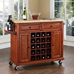 Crosley - Crosley Natural Wood Top Wine Cart - KF31001EBK - Shop for Kitchen Islands from Hayneedle.com! Make it easy to go from prep to stylish service with the Crosley Natural Wood Top Wine Cart. This handsome cart is made from select woods and veneers and is available in your choice of finish. Its smooth rolling casters let you move it wherever you want to display or serve your appetizers and wine. Its natural wood top is spacious and coordinates with any of the finishes. Storage options include two utility drawers for napkins or utensils. Side cabinets provide even more space for appliances plates or other items. This island is designed with a built-in rack that holds up to 20 bottles of your favorite wine. Its wine valet offers a handy way to keep a pair of bottles on display or ready for pouring. A side bar keeps towels ready for any spills and cleanup. About Crosley FurnitureIn 1920 Powel Crosley founded the company that pioneered radio broadcasting and mass market manufacturing around the world starting with a simple radio meticulously crafted with obsessive detail and accuracy and a measure of consideration for the wallet. These high ideals have served the company well for over 90 years and they live on in the newest addition to the family. Crosley Furniture sets a new standard for innovation function and meticulous craftsmanship in the manufacture of value-priced furniture. They proudly offer durable furniture products featuring hardwood and veneer construction with rich multi-step finishes in a multitude of styles.