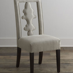 """Haute House - Benjamin Linen Chair - NATURAL - Haute HouseBenjamin Linen ChairDetailsEXCLUSIVELY OURS.Upholstered dining chair with cutout back.Hand-painted alder wood frame.Hand-finished legs.Linen upholstery.19""""W x 23""""D x 42""""T.Made in the USA.Boxed weight approximately 35 lbs. Please note that this item may require additional shipping charges.Designer About Haute House:Haute House is a Hollywood-based design and manufacturing company that creates haute couture furnishings for the home. Designer and owner Casey Fisher has been designing furniture for years as an upholstery textile and retail space stylist. Instead of designing a line offering just one look the Haute House line consists of three looks that offer something for every taste. However there is one element present in every Haute House design a great sense of style."""