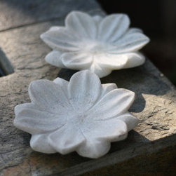 Pair of Marble Lotus Plate - This decorative white marble plate makes an eye-catching accent wherever it is displayed. Lovingly hand-carved into lovely lotus blossom, the real marble creates a soft and cool, elegant accent that will fill your home with classic style. Use for candle holders, tea light holders or just on their own as pairs.