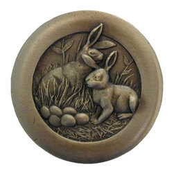"""Notting Hill - Notting Hill Rabbits Knob - Antique Brass - Notting Hill Decorative Hardware creates distinctive, high-end decorative cabinet hardware. Our cabinet knobs and handles are hand-cast of solid fine pewter and bronze with a variety of finishes. Notting Hill's decorative kitchen hardware features classic designs with exceptional detail and craftsmanship. Our collections offer decorative knobs, pulls, bin pulls, hinge plates, cabinet backplates, and appliance pulls. Dimensions: 1-3/8"""" diameter"""