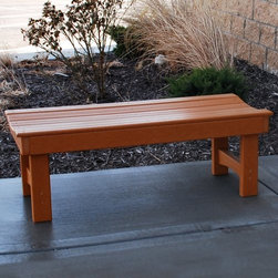 Jayhawk Plastics Recycled Plastic Garden Bench - Classic relaxed and eco-friendly the Garden Bench says a lot about you. Crafted from recycled plastic and contoured comfortable resin slats this bench lets you grab a seat just when and where you need it. Complete with heavy-duty zinc-coated hardware. Choose from 4- or 6-foot sizes and from green or cedar.About Jayhawk Plastics Inc.Since 1973 Jayhawk Plastics Inc. has been producing quality plastic furnishings at reasonable prices. Their commitment to superior customer service and quality products has helped Jayhawk become an industry leader. All of Jayhawk's benches and outdoor plastic products are made from 100% recycled plastic. This material gives you the best of both worlds: products made entirely of recycled plastic that also have the beauty of natural wood.Jayhawk's benches tables receptacles and other products are maintenance-free vandal-resistant and environmentally friendly. Because they're made of milk jugs pop bottles and many other forms of post-consumer and post-industrial waste these products save trees and reduce landfill usage. Jayhawk's recycled plastic does not need to be sealed painted or stained and cannot rot. Paint will not bond to the surface and pen and marker can be washed off easily with household cleaning solvents. Jayhawk benches are designed to last many years in the outdoor elements in both residential and commercial applications.