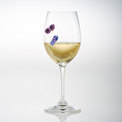Frontgate - Set of 12 Ocean View Wine Charms - Crystal colors: capri blue, citrine, sun, emerald, light sapphire, and fuchsia. Keeps glasses from being mixed up. Magnetic charms attach to glass bowl of stemmed and stemless glasses. Also works on martini, pilsner, and pint glasses – and any type of glass up to approximately 5mm thick. Remove charms from glasses before washing. Add personality to any glass while keeping each drink unique with our Ocean View Wine Charms. Colorful magnets attach to the bowl of your glass. This set of 12 includes sunglasses and flip-flops along with gorgeous Swarovski™ crystals in various hues.  .  .  . Also works on martini, pilsner, and pint glasses - and any type of glass up to approximately 5mm thick .  . Wipe clean with a damp cloth . Please note: This is not a toy.