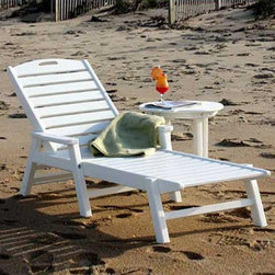 POLYWOOD - POLYWOOD Recycled Plastic Ocean Shores Outdoor Chaise Lounge - NCC2280GR - Shop for Chaise Lounges from Hayneedle.com! The perfect way to catch some rays and relax at the same time. Comfortable durable and virtually maintenance-free the Ocean Shores Chaise Lounge is made from 100 percent recycled plastic. The traditional slatted chaise design features comfortable armrests and a convenient handle at the top for portability.This chaise lounge is available in your choice of colors. Some assembly required. Measures 80L x 26W x 38H inches. About PolyWoodThe advantages of PolyWood (Recycled Plastic) are hard to ignore. PolyWood absorbs no moisture and will NOT rot warp crack splinter or support bacterial growth. PolyWood is also compounded with permanent UV stabilized colors which eliminate the need for painting staining waterproofing stripping and resurfacing. This material is impervious to many substances including salt water gasoline paint stains and mineral spirits. In addition every PolyWood product comes with stainless steel hardware. PolyWood is extremely easy to clean and maintain. Simple soap and water is all that you will need to get rid of dirt and make your furniture look new again. For extreme cleaning needs you can use a 1/3 bleach and water solution. Most PolyWood furnishings are available in a variety of classic colors which allow you to choose your favorite or coordinate with the furniture you already have. This is sure to be a piece that you will be proud to own for a lifetime.