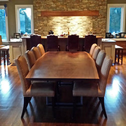 """Chesapeake Bay and Black Walnut - The matching 10' 6"""" Live Edge Book Matched Black Walnut Dining Table with Rectangular Steel Bases."""