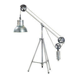Go Home - Go Home Balance Desk Lamp - Give a contemporary touch to your studio or study with this flexible balance Desk Lamp. It is the part of the French Country Collection and makes an interesting yet functional piece of home decoration coupled with its abstract design. The vintage industrial steel finish gives the piece a shiny exterior and brass material makes it strong piece.