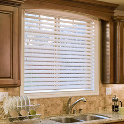 "Window Treatments for Bathrooms: Norman 2 1/2"" Faux Wood Blinds - Faux Wood Blinds are our top pick for bathrooms. They have a classic look, and are safe for high moisture and temperature spaces. The solid PVC slats will never warp or crack like wood blinds can in some instances."