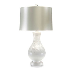 White Pearlized Porcelain Lamp - With a delicate glister as if dusted with snow, this table lamp bestows a sublime beauty to your room with its monochromatic composition. The classic vase shape of this white pearlized, high fired porcelain lamp allows for ease in blending with the appointments of your transitional decor. A stunning addition to the boudoir, the lamp also makes a highly stylized statement in a great room, grand foyer, or on a dining room sideboard.