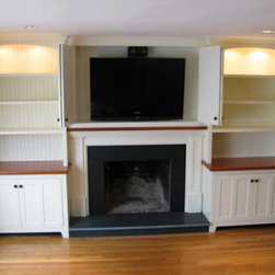 Hudson project, with doors open - Cabinet built-in's are painted maple with Red Oak counter tops, doors are a beaded inset shaker style.  Backing is bead board with arched tops and furniture style feet.