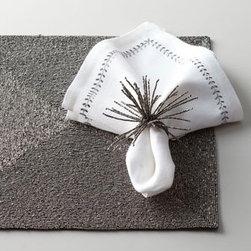 Gunmetal Spider Burst Napkin Rings - The gunmetal Spider Burst napkin rings by Kim Seybert are just simple fun for your table. I would use these to lighten up a traditional space for a New Year's Eve party.