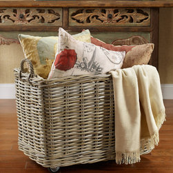 Avery Rolling Storage Basket - Set atop industrial rubber casters, these beautiful Kubu rattan baskets provide easy, rolling transport for everything from firewood and toys to blankets and laundry. Durably crafted of natural rattan, detailed with woven handles and a removable burlap canvas liner.
