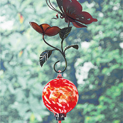 Metal Art Hummingbird Feeder - I love the idea of mixing a metal butterfly and flower with a colored glass hummingbird. The delicate wings of hummingbirds somehow always remind me of butterflies so this seems fitting. I like the whole package.