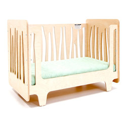 Funky Forest Toddler Bed (conversion panel) - This innovative crib captures the funky nature of the forest in all its asymmetry and irregularity, creating a mini-ecosystem in your nursery. It is made of highly durable NAUF (no added urea formaldehyde) multi-ply birch wood. The finishes are non-toxic, water-based wood stain.